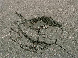 Bache en asfalto
